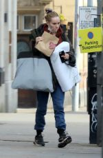 Suki Waterhouse Clutches a pillow and laundry bag as she heads to the Dali Land film set in Liverpool