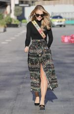 Vogue Williams Flashes legs in a high split skirt at Heart radio in London