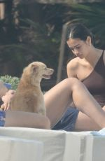 Adriana Lima In a one-piece swimsuit as she relaxes in Tulum in Mexico