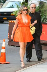 Amanda Frances Looking radiant in a bright orange dress while out and about in New York City