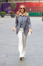 Amanda Holden Looks chic in white trousers and blazer at Heart radio studios in London