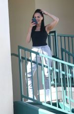 Amanza Smith In black as she takes a call while on the set of