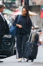 Amber Stevens West Pictured matching her dark sweats carrying her luggage while out in New York