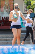 April Love Geary Picks up food to go with a friend at a deli in Malibu