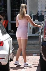 April Love Geary Shows off curvy figure in pink workout skirt in Malibu