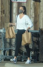 April Love Geary Spends her Monday running errands at a vintage grocery store in Malibu