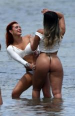 Bella Thorne Wears a white and yellow during a photoshoot on the beach in Miam