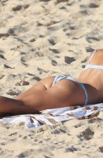 Brittany Hockley Catches some sun rays at Bondi beach in Sdyney
