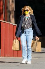 Busy Philipps Seen with hands full while carrying two brown bags, after shopping for groceries in New York