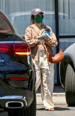 Camila Cabello Looks cute in oversized baggy pants and a crop top while getting her nails done with a bodyguard in West Hollywood