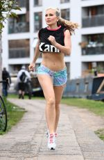 Caprice In a cropped top and mini shorts out jogging in London