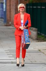 Caprice Spotted bearing gifts as the blonde bombshell looked red hot out in London