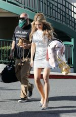 Chrishell Stause Gets extra leggy in a short silver dress filming