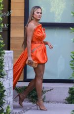 Chrissy Teigen Heads out for a party with her mother
