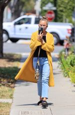 Chrissy Teigen Laughing away during a FaceTime call as the model leaves a business meeting in Los Angeles