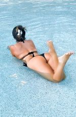 Claudia Romani Puts on a sultry display while posing at the pool in the Seminole Hard Rock Hotel in Hollywood