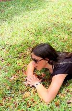 Claudia Romani Was seen in Coral Springs relaxing on the grass in a little black dress and jungle inspired bikini