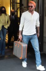 David Beckham and Victoria Beckham leave their hotel as they head to the airport to leave New York City