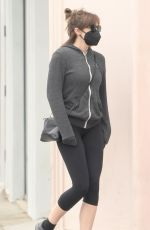 Elizabeth Olsen Wearing a face mask whilst picking up some stationary in Studio City