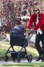 Elsa Hosk and Tom Daly take their baby girl Tuulikki out for an afternoon stroll