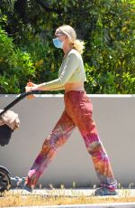 Elsa Hosk Shows off her post baby body as she steps out for coffee wearing a crop top in Los Angeles