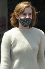 Emma Watson Dresses down in pyjama-style checked pants as she and stylish boyfriend Leo Robinton stop by a CVS in Los Angeles