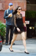 Famke Janssen Does a black lace dress displaying her long legs while out in NYC