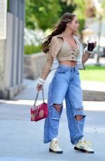 Georgia Harrison Shows off her toned midriff after leaving a business meeting with her business partner, Ahmed Harb in Beverly Hills