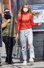Heidi Klum Flashes her sequin bra under a sheer red top as she arrives to a photoshoot in Los Angeles