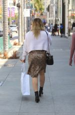 Hilary Duff Goes shopping with friends on Rodeo Drive in Beverly Hills