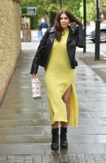 Imogen Thomas Braves the cold as she wears a yellow dress to head to a friends birthday lunch in Primrose Hill, North London