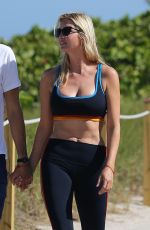 Ivanka Trump Shows off her curves in a sports bra and leggings as she takes a walk with husband Jared Kushner in Miami