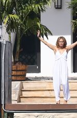 Jennifer Lopez Practices her stretches at the waterfront in Miami