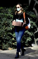 Jessica Alba Has her hands full while arriving at The Honest Company in Los Angeles