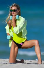 Joy Corrigan Curls some weights during a photo shoot in Miami Beach