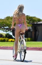 Joy Corrigan Enjoys a sunny bike ride in a tiny pink swimsuit and Gucci heels in Los Angeles