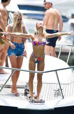 Joy Corrigan In multi-colored bikini as she enjoys a yacht party with pals in Miami Beach