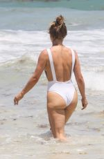 Julianne Hough In a white swimsuit on the beach in Tulum
