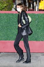 Kaia Gerber Looks stylish in a leather jacket and black flare pants while leaving a late dinner at Matsuhisa in Beverly Hills