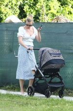 Karlie Kloss Shows some leg as she goes out for a walk with her newborn baby boy Levi Joseph in Miami