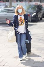 Kate Garraway Looks fashionable in denim flares and print top at Smooth radio in London