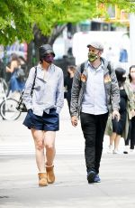 Katie Holmes Dons navy blue shorts and Uggs while out in SoHo with a friend