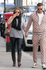 Katie Price With fiancee Carl Woods arriving at the R.H Salon on Walton Street in Knightsbridge to get a new set of hair extensions