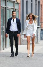 Kelly Bensimon Puts on a leggy display on a stroll with a friend in New York