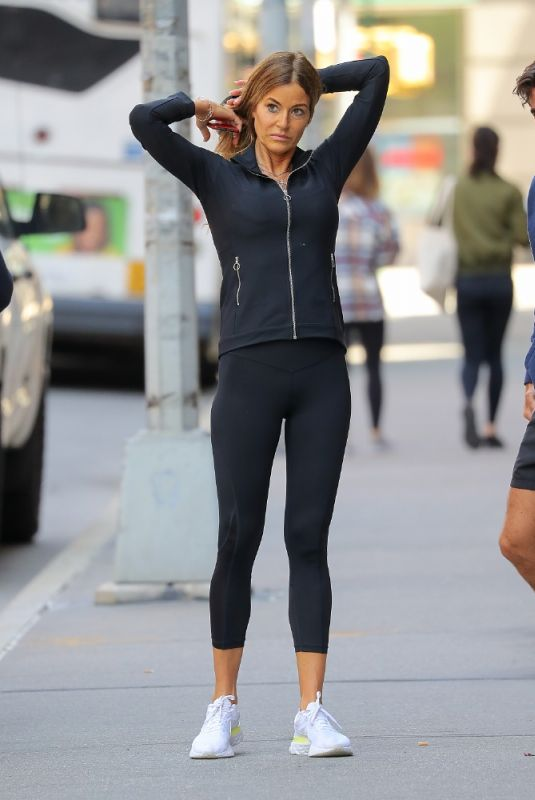 Kelly Bensimon Seen stretching after a workout on the sidewalk in New York