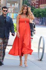 Kelly Bensimon Wears a bright and fun orange dress while out in NYC