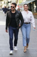 Kelly Brook Shares a tender kiss with boyfriend Jeremy Parisi in London