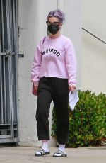 """Kelly Osbourne Wears a pink sweatshirt that reads """"Weirdo"""" on the chest as she walks to a local ATM near her home in Beverly Hills"""
