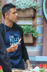 Kelly Ripa And Mark Consuelos are seen shooting a cooking segment ahead of the Memorial Day Weekend for the Kelly and Ryan Show in New York