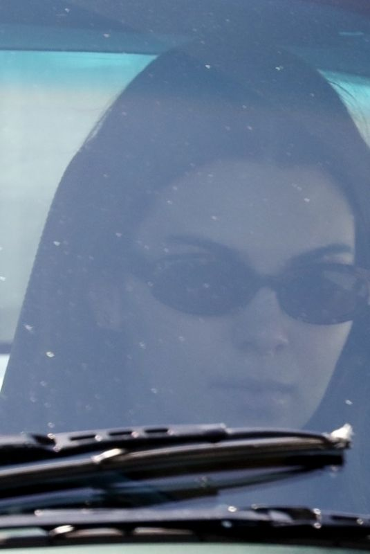 Kendall Jenner Cruises on a cool-looking black Porsche in Los Angeles